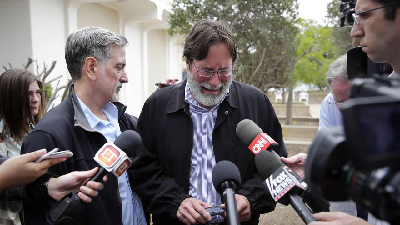 Richard Martinez, center, says his son Christopher Martinez was killed in Friday nights mass shooting that took place in Isla Vista, Calif. (AP Photo/Jae C. Hong)
