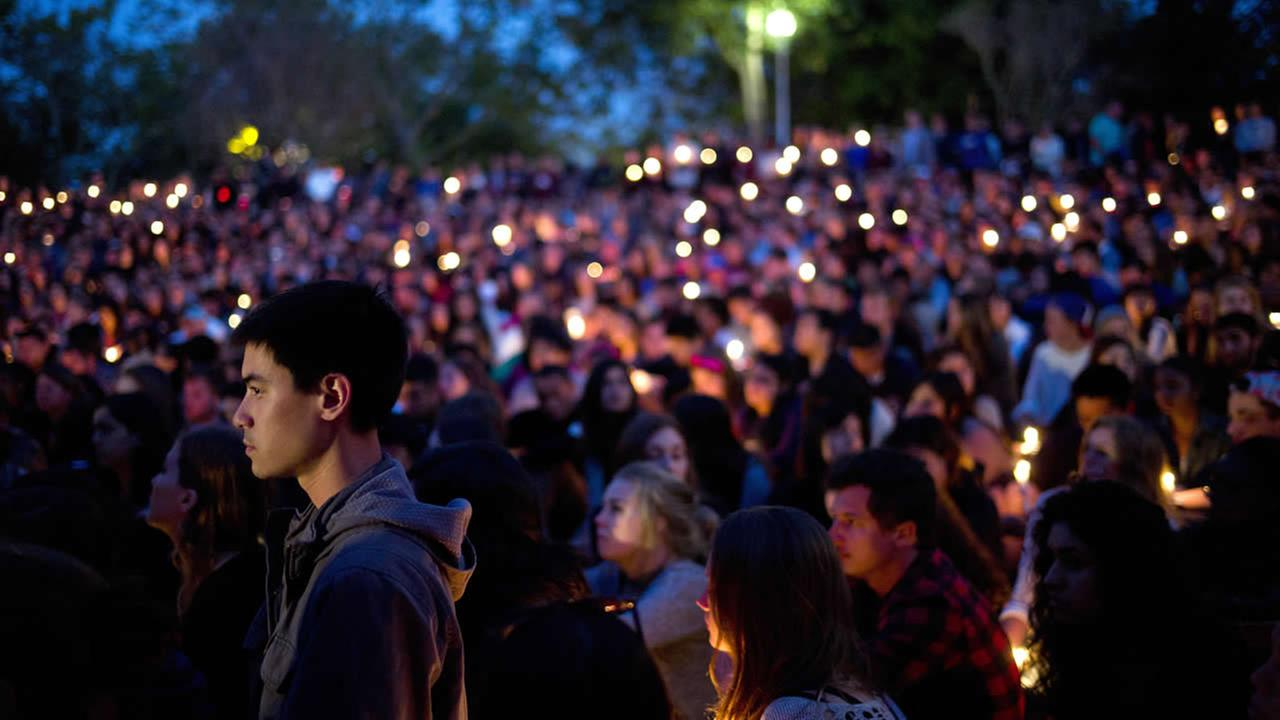 People gather at a park for a candlelight vigil to honor the victims of a mass shooting on May 24, 2014, in Isla Vista, Calif. (AP Photo/Jae C. Hong)