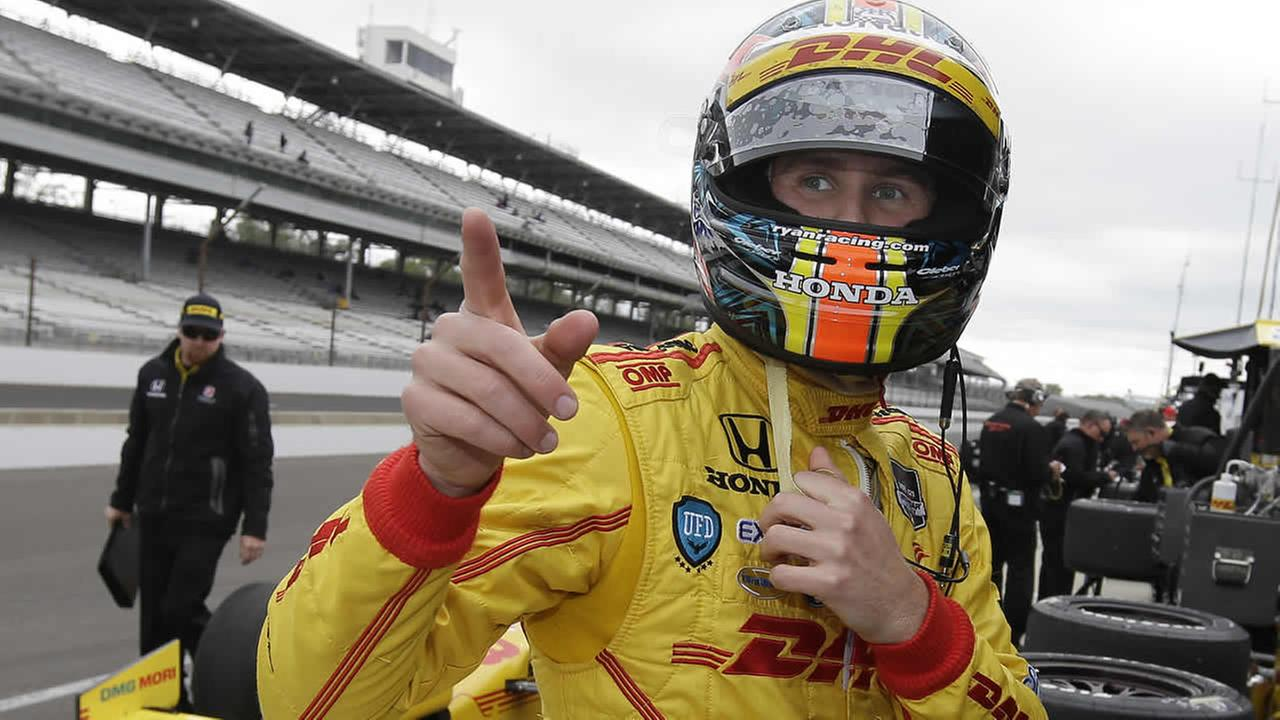 Ryan Hunter-Reay talks with his crew during practice for the Indianapolis 500 IndyCar auto race at the Indianapolis Motor Speedway in Indianapolis. (AP Photo/Darron Cummings)