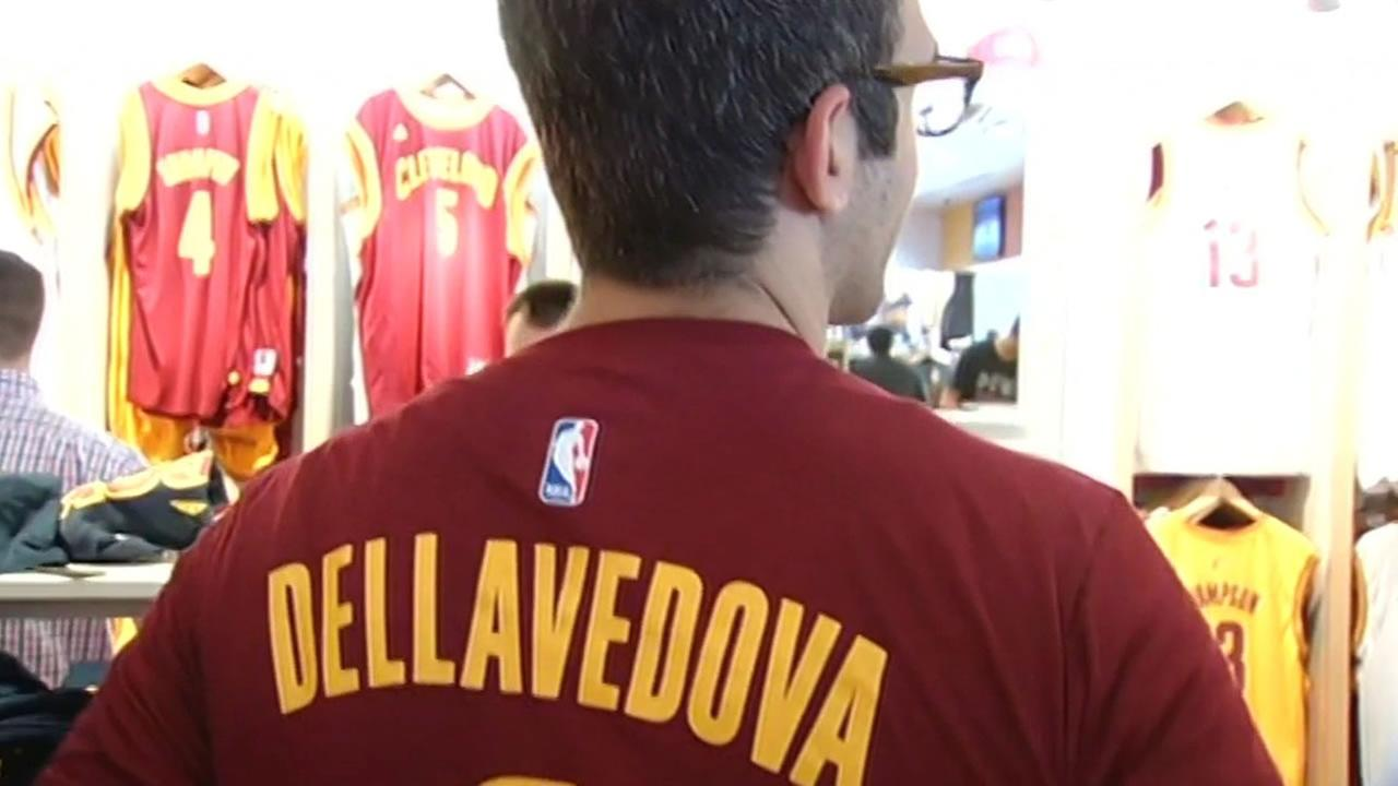A fan shows off a Matthew Dellavedova shirt in Cleveland on June 9, 2015 ahead of Game 3 of the NBA Finals.