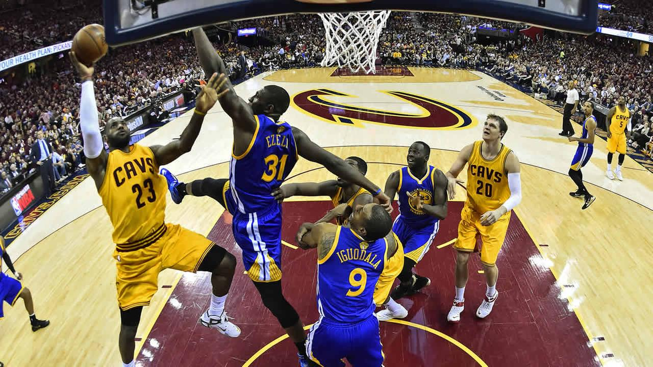 Cavaliers LeBron James shoots over Warriors Festus Ezeli during the first half of Game 3 of basketballs NBA Finals in Cleveland, Tuesday, June 9, 2015. (AP Photo)