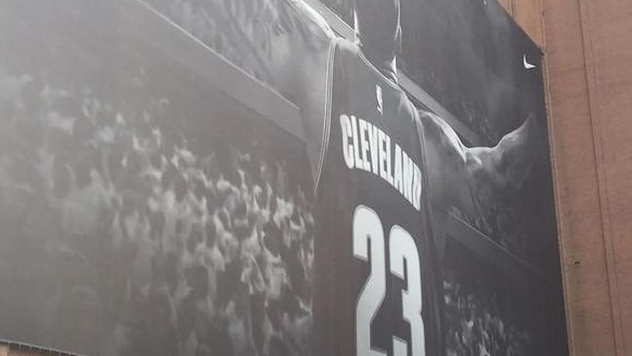 A poster of LeBron James hangs at Quicken Loans Arena in Cleveland, Ohio Tuesday, June 9, 2015. KGO-TV
