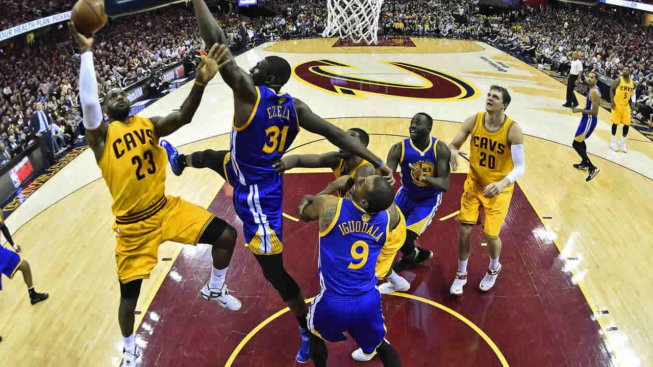 In this image, Cavaliers forward LeBron James (23) shoots over Warriors center Festus Ezeli (31) during Game 3 of basketballs NBA Finals in Cleveland, June 9, 2015. (AP Photo/Larry W. Smith/Pool Photo via AP)