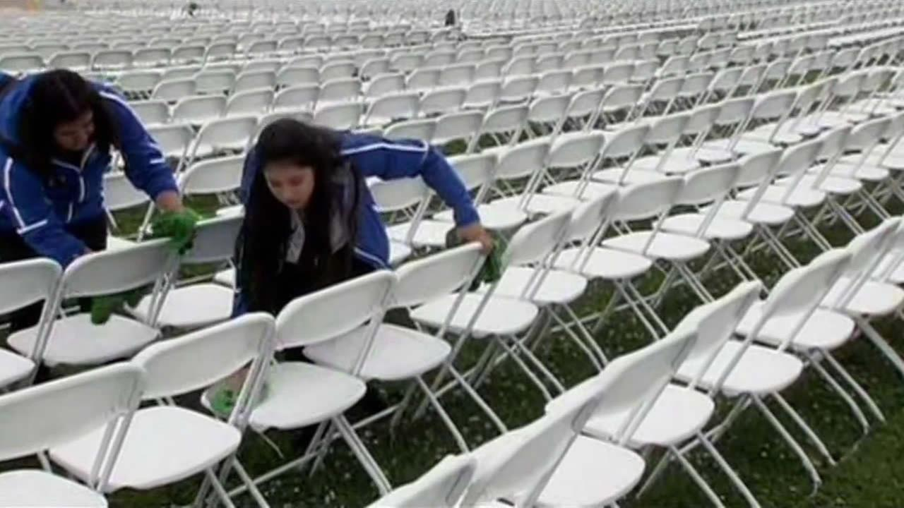 Students and staff at Mount Eden High School in Hayward, Calif. worked to dry off seats ahead of graduation on June 10, 2015.
