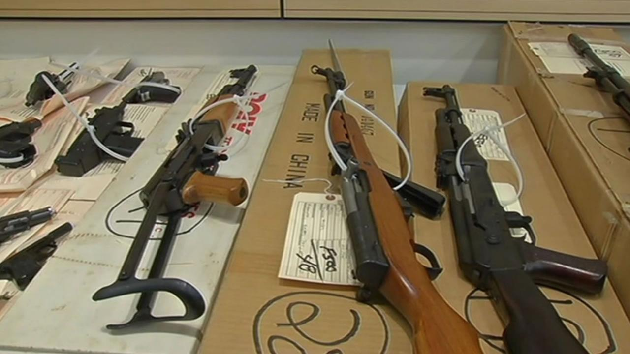 San Francisco police recovered a large cache of firearms from the home of a robbery suspect in South San Francisco.