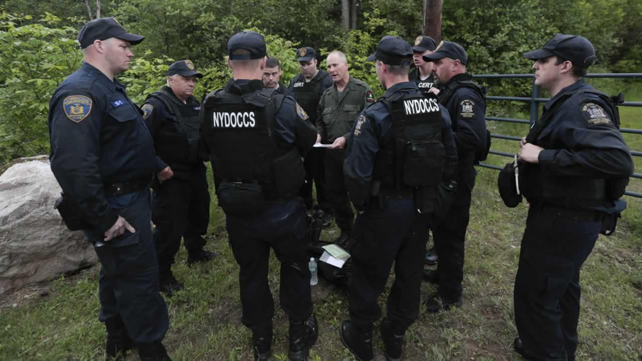 Members of the State Department of Corrections and Community Supervision emergency response team search for escaped prisoners on Monday, June 8, 2015 in Dannemora, N.Y.