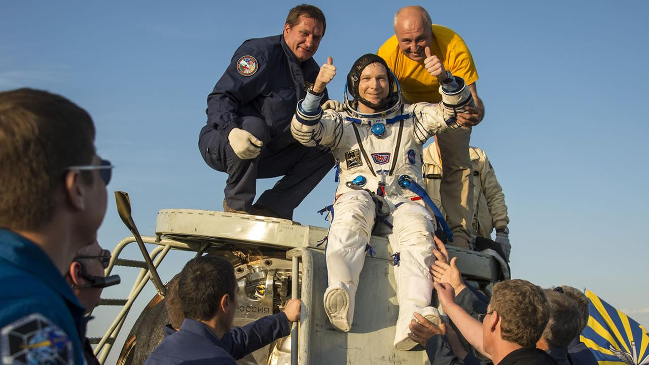 U.S. astronaut Terry Virts is helped out of the Soyuz TMA-15M spacecraft just minutes after he and two other astronauts landed in Zhezkazgan, Kazakhstan, Thursday, June 11, 2015.