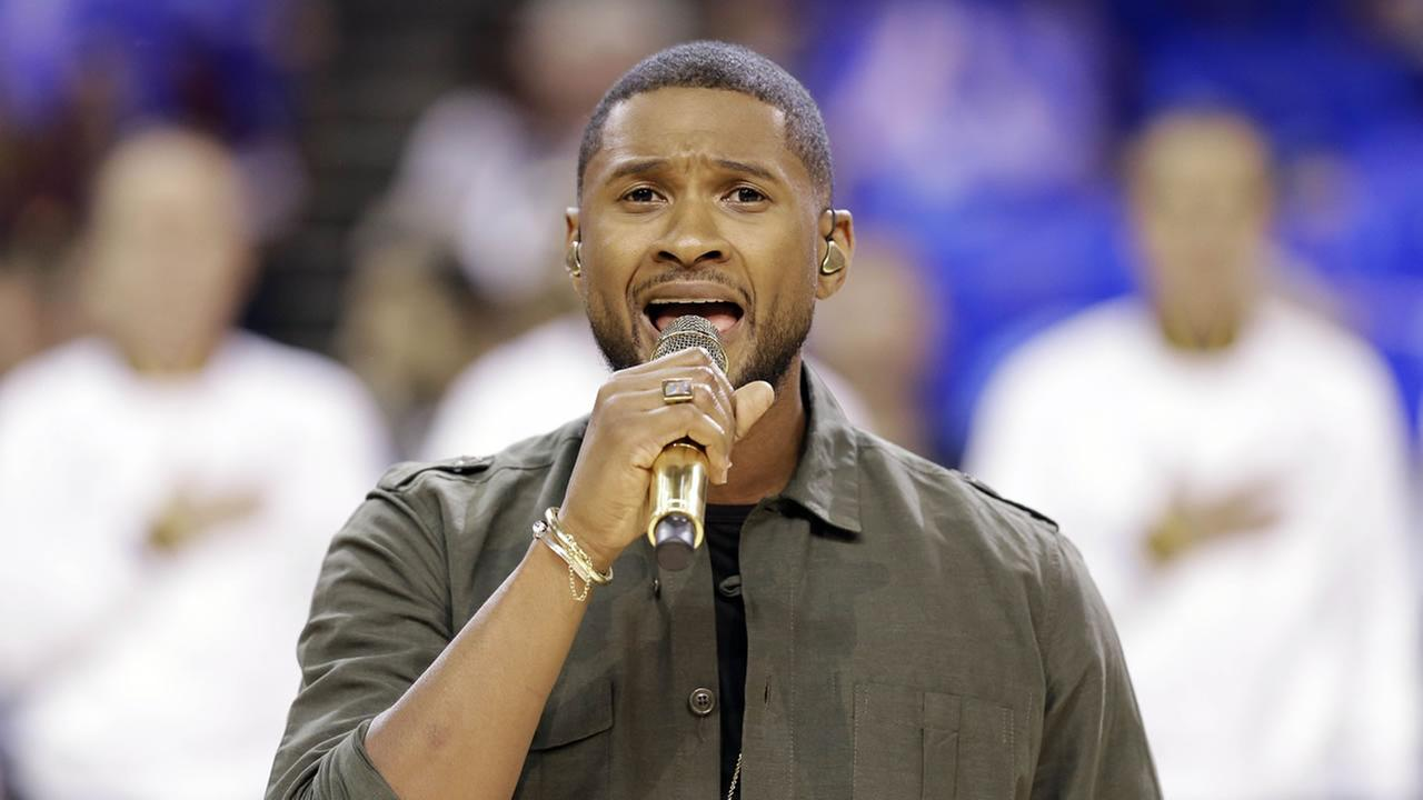 Usher performs the national anthem prior during the first half of Game 4 of basketballs NBA Finals between the Cleveland Cavaliers and the Golden State Warriors in Cleveland. AP Photo/Tony Dejak
