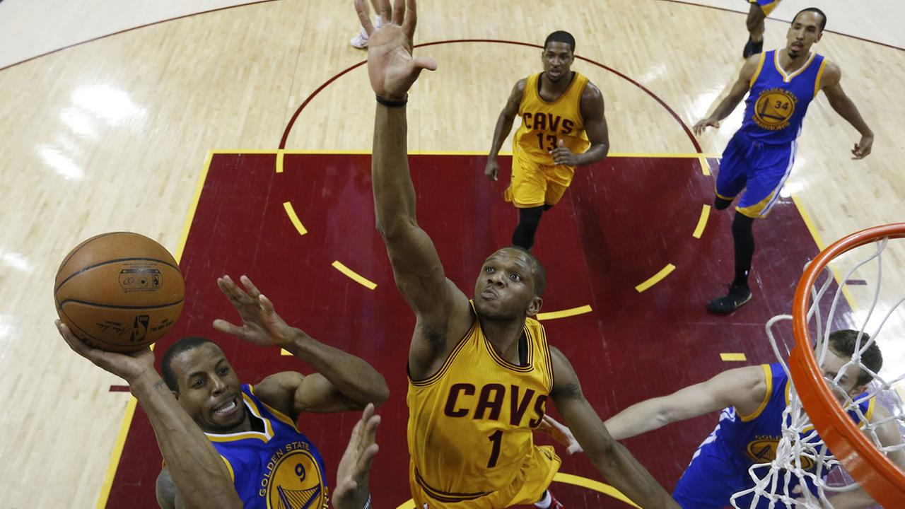 Golden State Warriors guard Andre Iguodala (9) shoots over Cleveland Cavaliers forward James Jones (1) during the first half of Game 4 of basketballs NBA Finals in Cleveland. Larry W. Smith/Pool Photo via AP