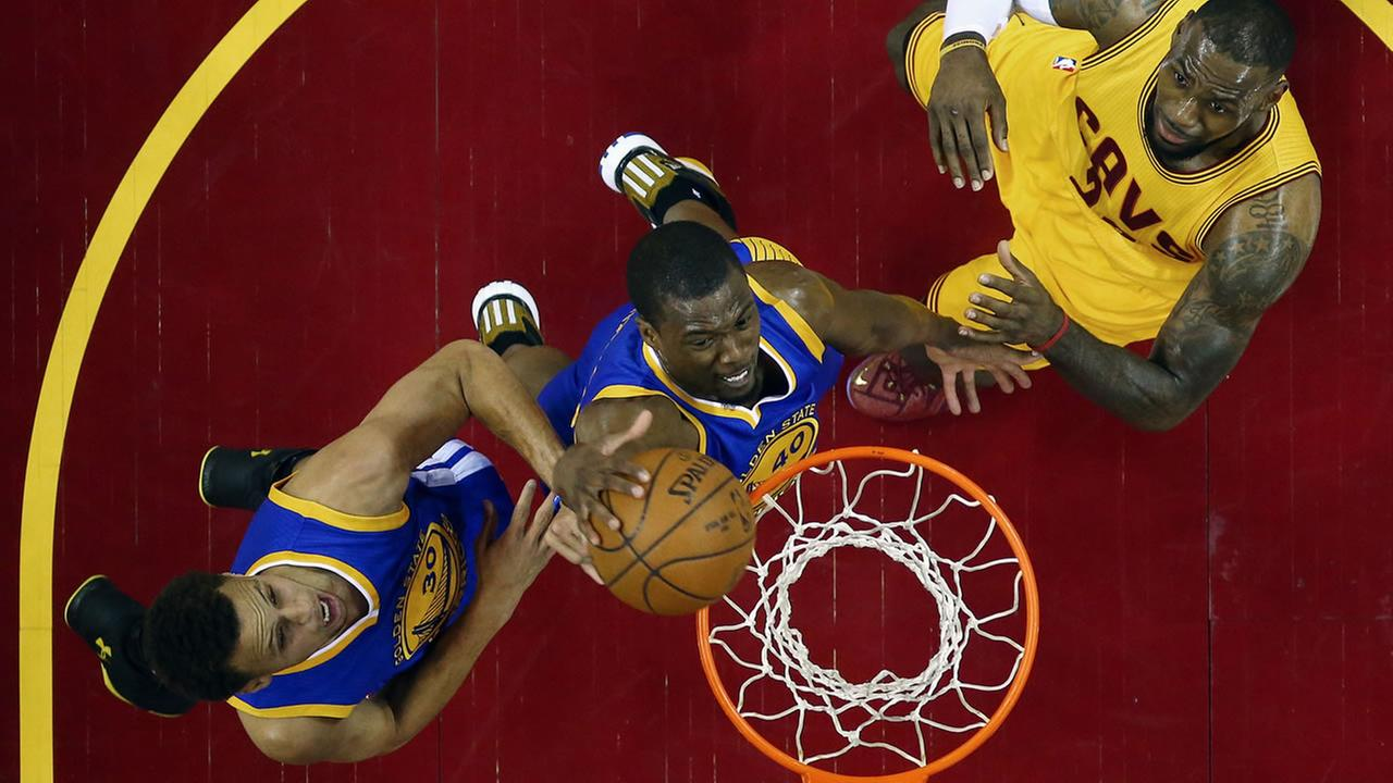 Cleveland Cavaliers forward LeBron James (23) is treated on the bench after being knocked to the ground during the first half of Game 4 of basketballs NBA Finals. AP Photo/Paul Sancya