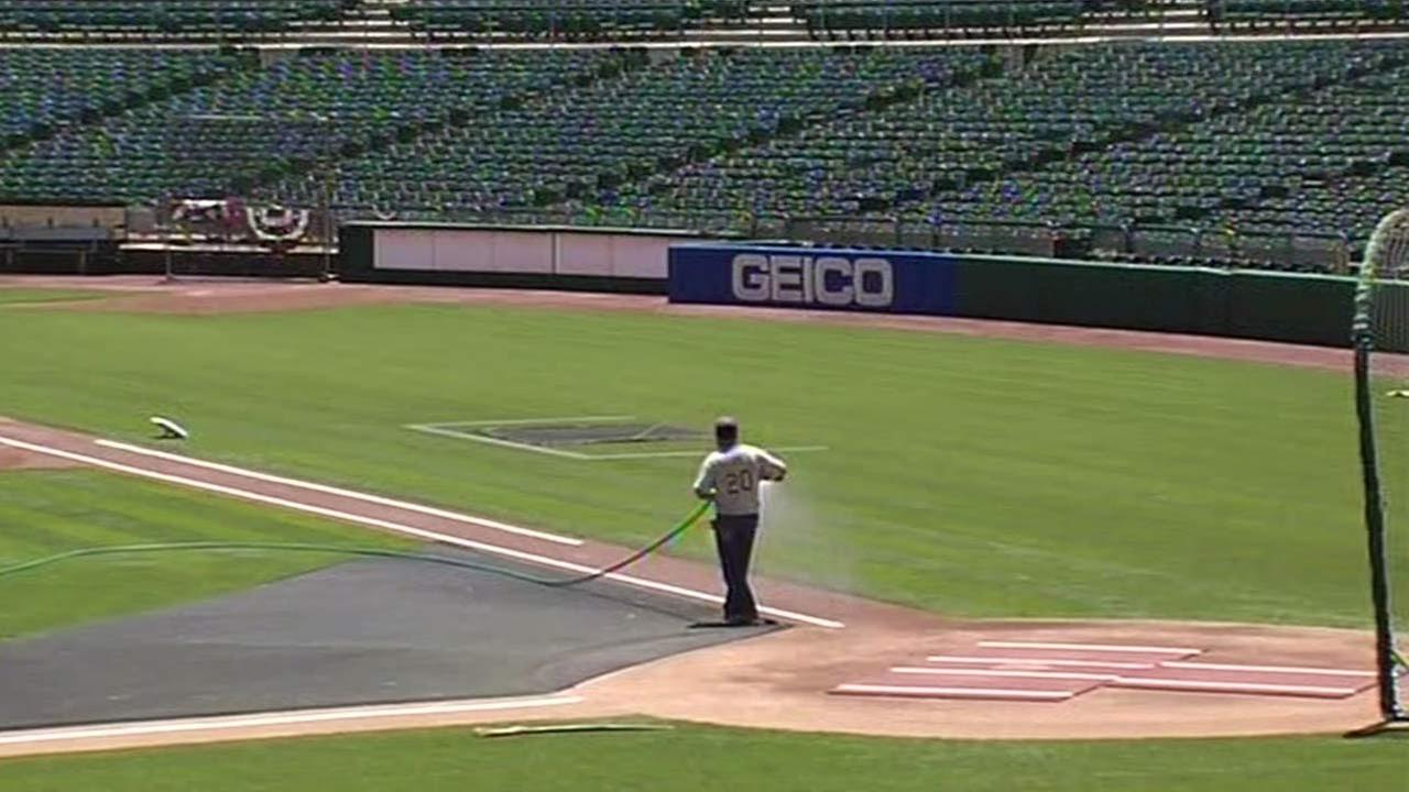 Field at O.co Coliseum watered by crew member.