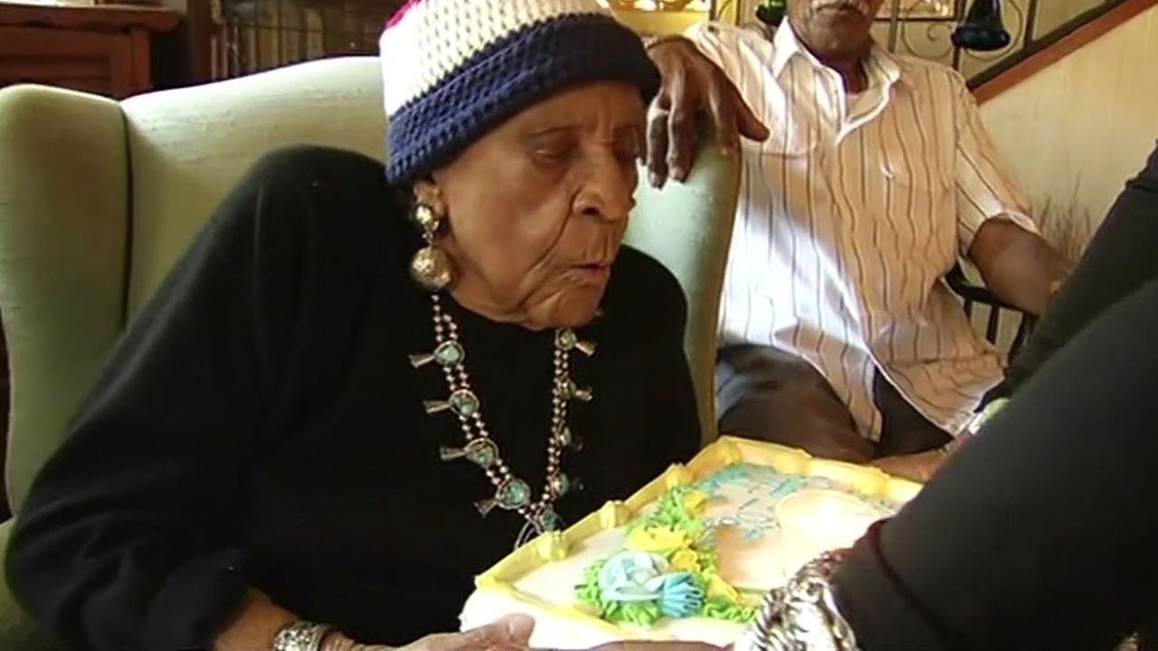 Warriors superfan Sweetie blows the candles out on her 106th birthday cake on Friday, June 12, 2015 in Oakland, Calif.