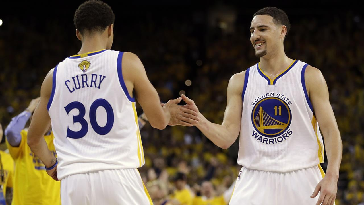 Warriors guard Stephen Curry celebrates with guard Klay Thompson during Game 5 of the NBA Finals against the Cleveland Cavaliers in Oakland, Calif., Sunday, June 14, 2015. AP Photo/Ben Margot