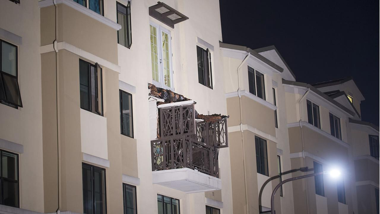 A fourth floor balcony rests on the balcony below after collapsing at the Library Gardens apartment complex in Berkeley, Calif., early June 16, 2015. (AP Photo/Noah Berger)