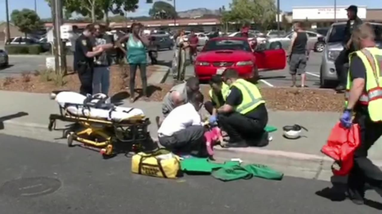 Emergency crews respond after seven people were injured and one was killed after being struck by a car on Sonoma Boulevard near Redwood Parkway in Vallejo on Friday, June 19, 2015.