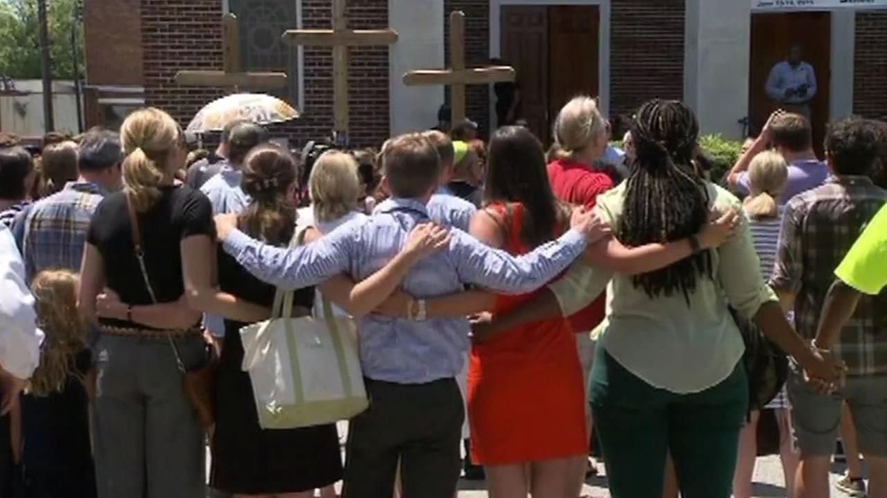 Thousands of people have gathered at a vigil in downtown Charleston on Friday, June 19, 2015 to remember the nine people who were slain at a historic black church.
