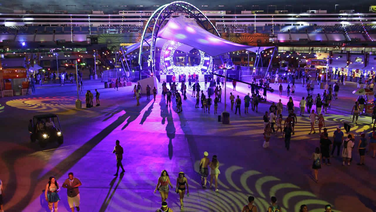 People walk around a stage during the Electric Daisy Carnival, June 20, 2014, in Las Vegas. (AP Photo/John Locher)