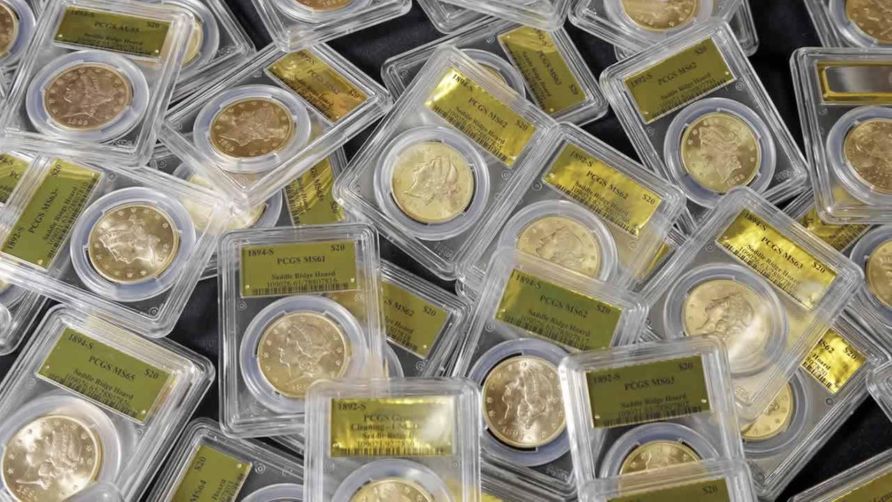 This Feb. 25, 2014 file photo shows some of the 1,427 Gold Rush-era U.S. gold coins displayed at Professional Coin Grading Service in Santa Ana, Calif. (AP Photo/Reed Saxon, File)