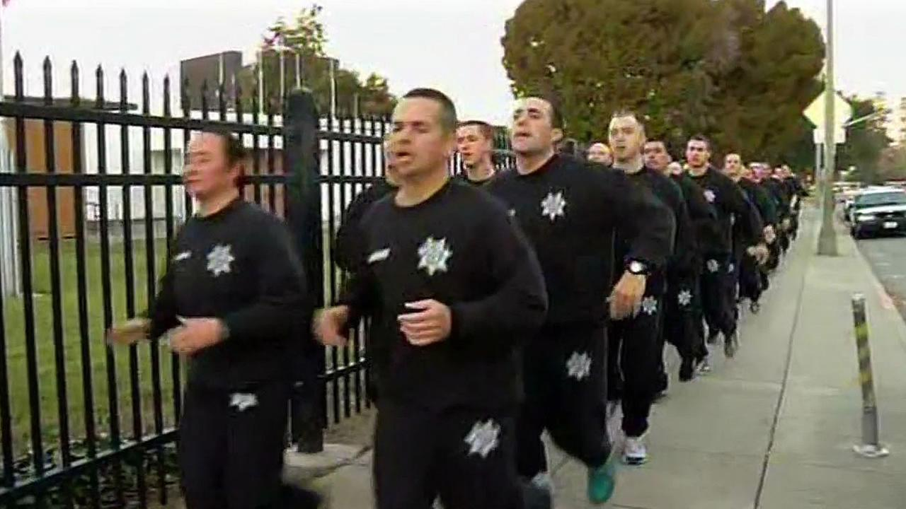 San Jose Police Department recruits run in a line