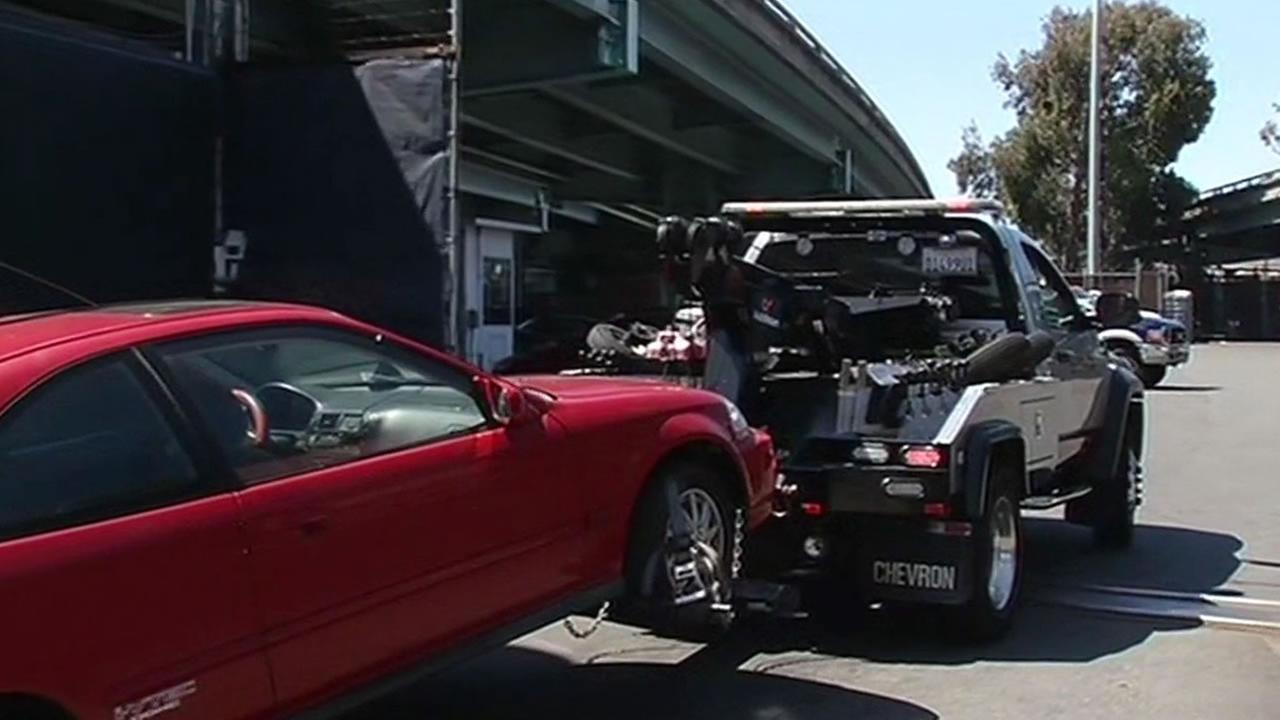 red car gets towed into AutoReturn