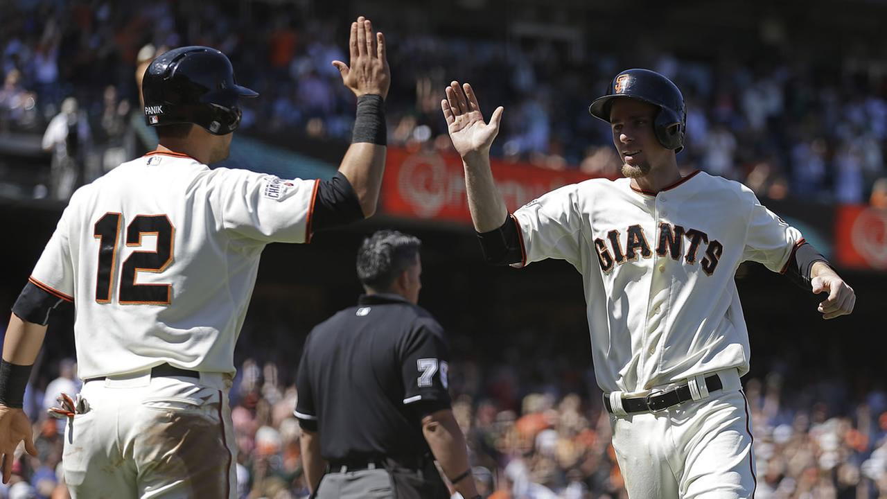 San Francisco Giants Joe Panik, left, and Matt Duffy celebrate after scoring against the San Diego Padres in the eighth inning on Thursday, June 25, 2015, in San Francisco.