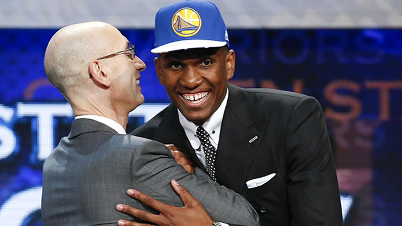 Kevon Looney, right, greets NBA Commissioner Adam Silver after being selected 30th overall by the Golden State Warriors during the NBA basketball draft, Thursday, June 25, 2015.