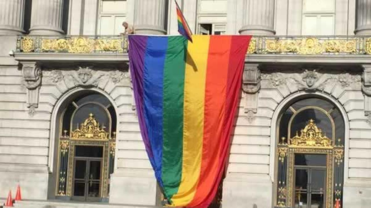 San Francisco unfurls the pride flag at the front entrance of City Hall after SCOTUS decision on Friday, June 26, 2015.