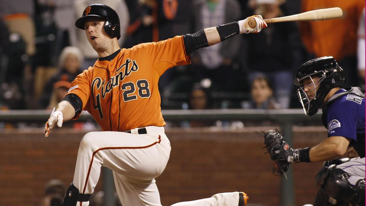 Giants Buster Posey swings and misses during the ninth inning of a baseball game against the Colorado Rockies, Friday, June 26, 2015, in San Francisco. (AP Photo)