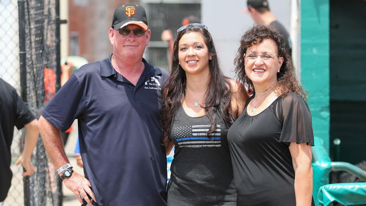 Fallen Officer Michael Johnsons father Dan, wife Nikki, and mother Katherine are seen at a San Jose Giants game in San Jose, Calif. on June 28, 2015.Tim Cattera/San Jose Giants