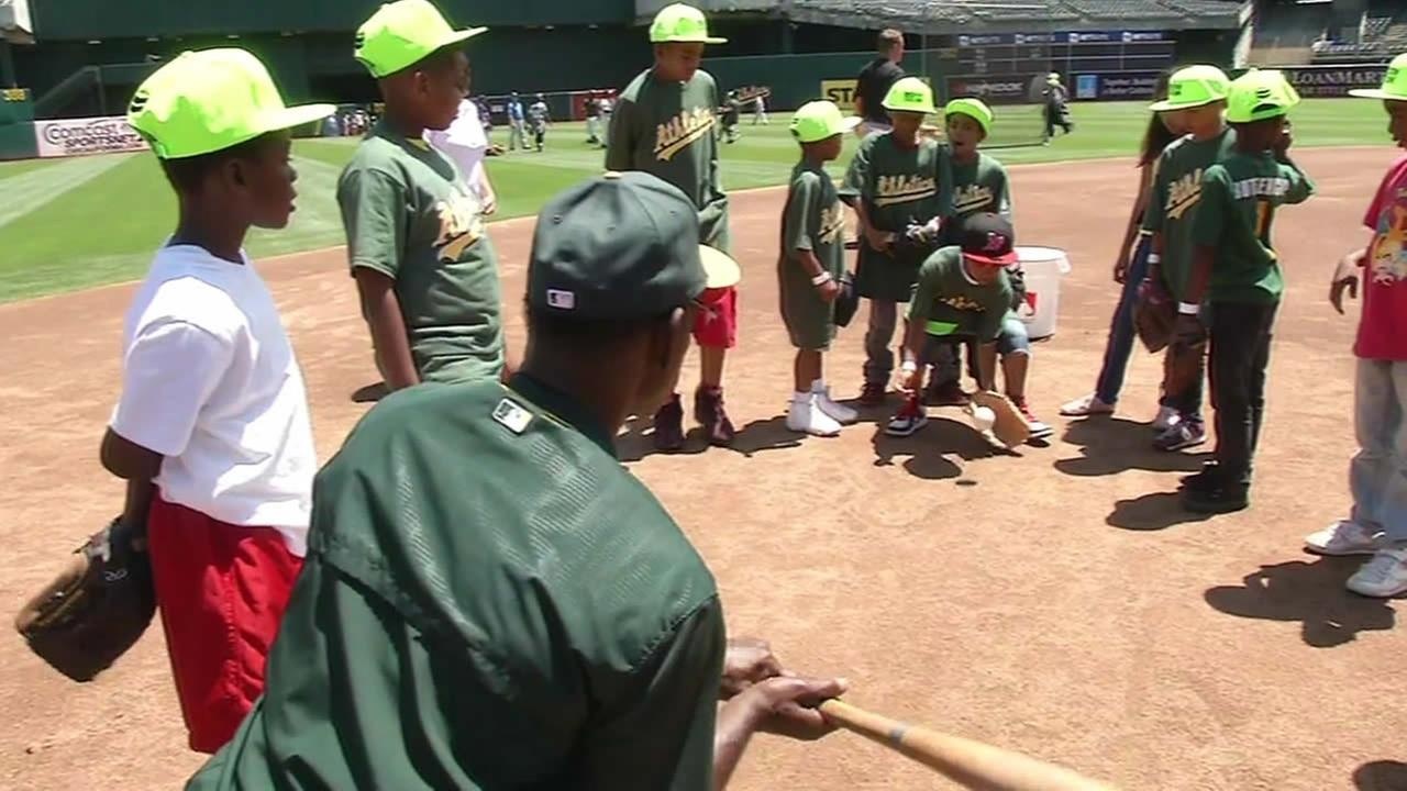 Kids learned some tricks from baseballs best and the science behind the sport in Oakland, Calif. on June 30, 2015.
