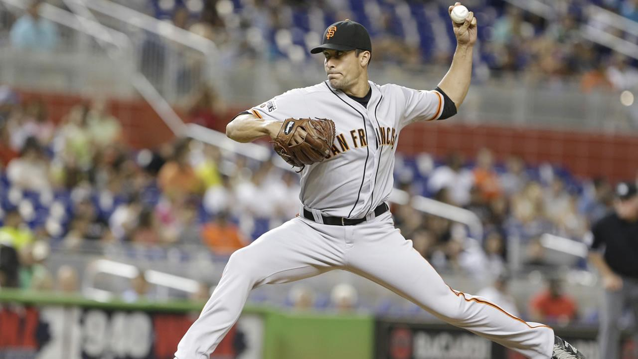 San Francisco Giants Javier Lopez delivers a pitch during the eighth inning of a baseball game against the Miami Marlins, Tuesday, June 30, 2015, in Miami.