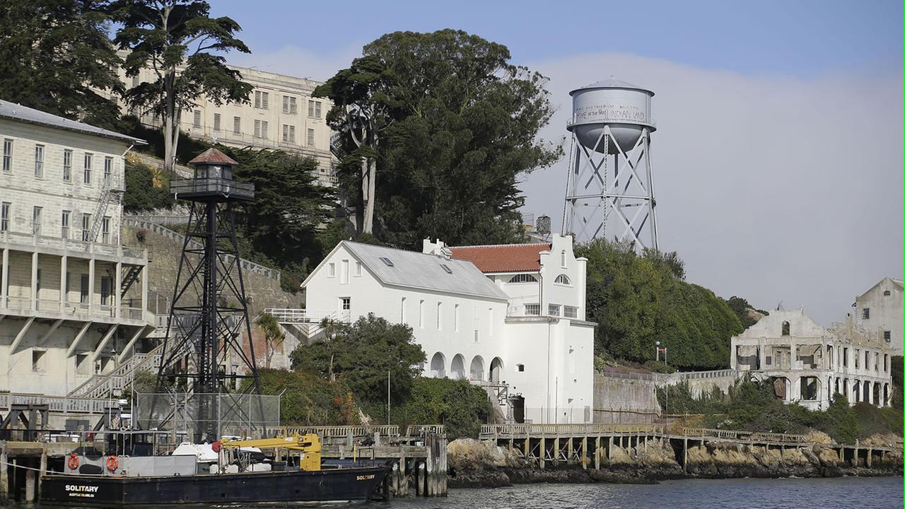 The newly restored sally port and guardhouse, at right of the dock guard tower, is seen on Alcatraz Island Wednesday, July 1, 2015, in San Francisco.
