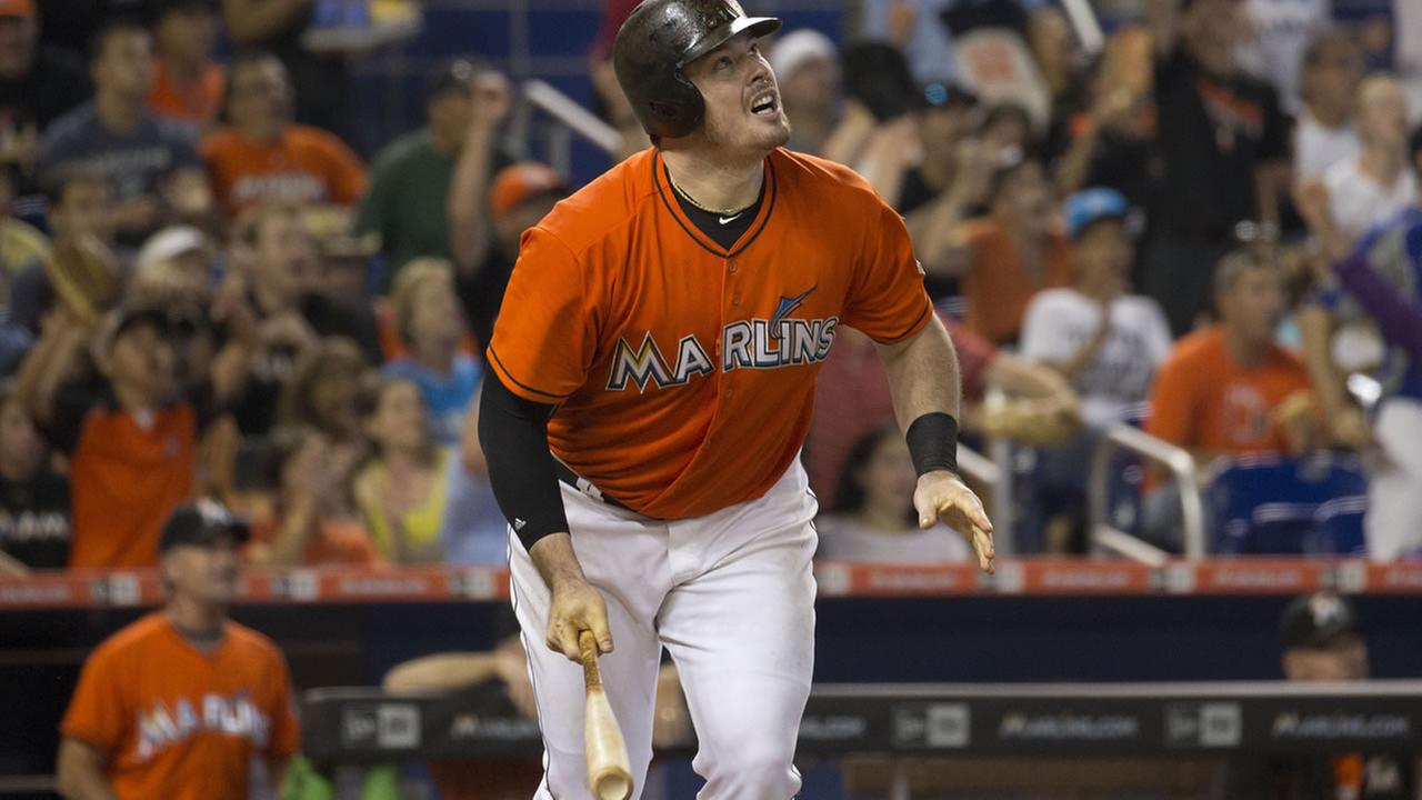Miami Marlins Justin Bour (48) watches his three-run homer during the fifth inning of a baseball game against the San Francisco Giants in Miami, Thursday, July 2, 2015. (AP Photo/J Pat Carter)
