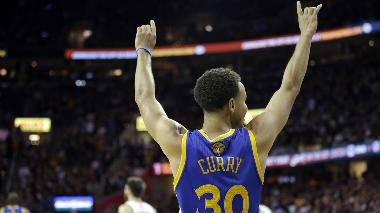 Warriors guard Stephen Curry (30) celebrates during the second half of Game 6 of basketballs NBA Finals against the Cleveland Cavaliers in Cleveland, Tuesday, June 16, 2015.