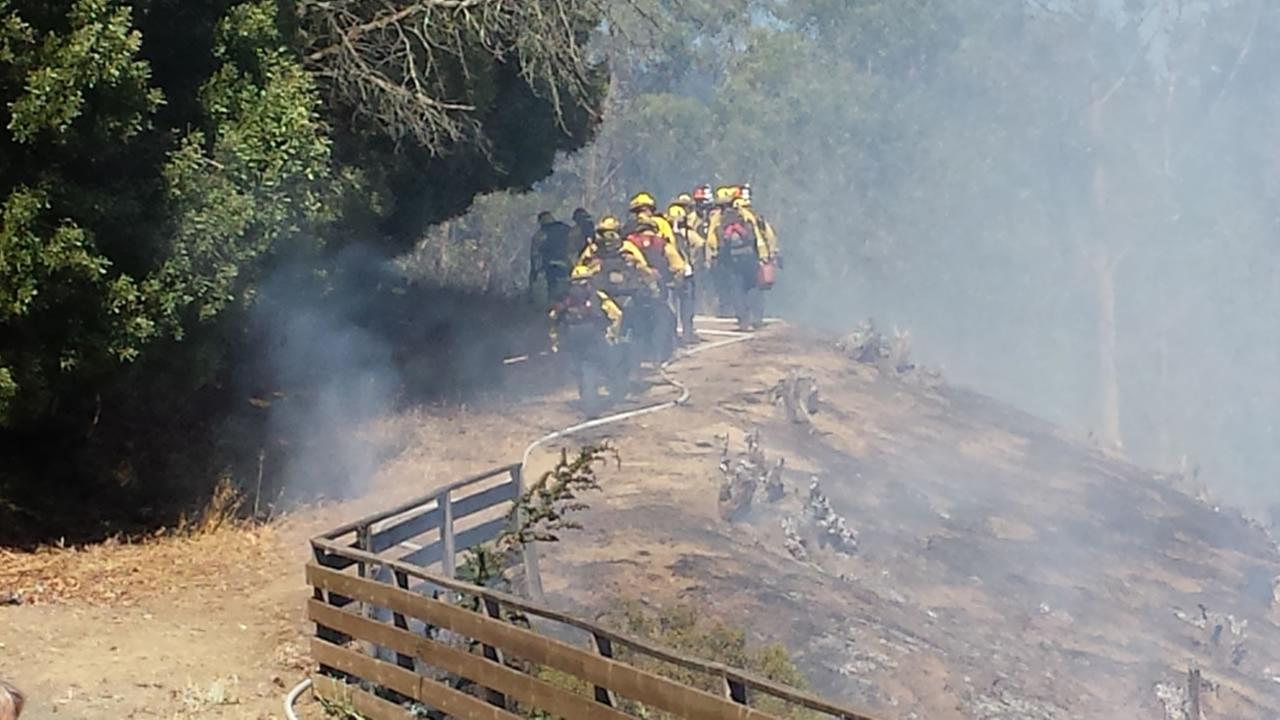 fire crews arrive on the scene of a brush fire in the Oakland Hills