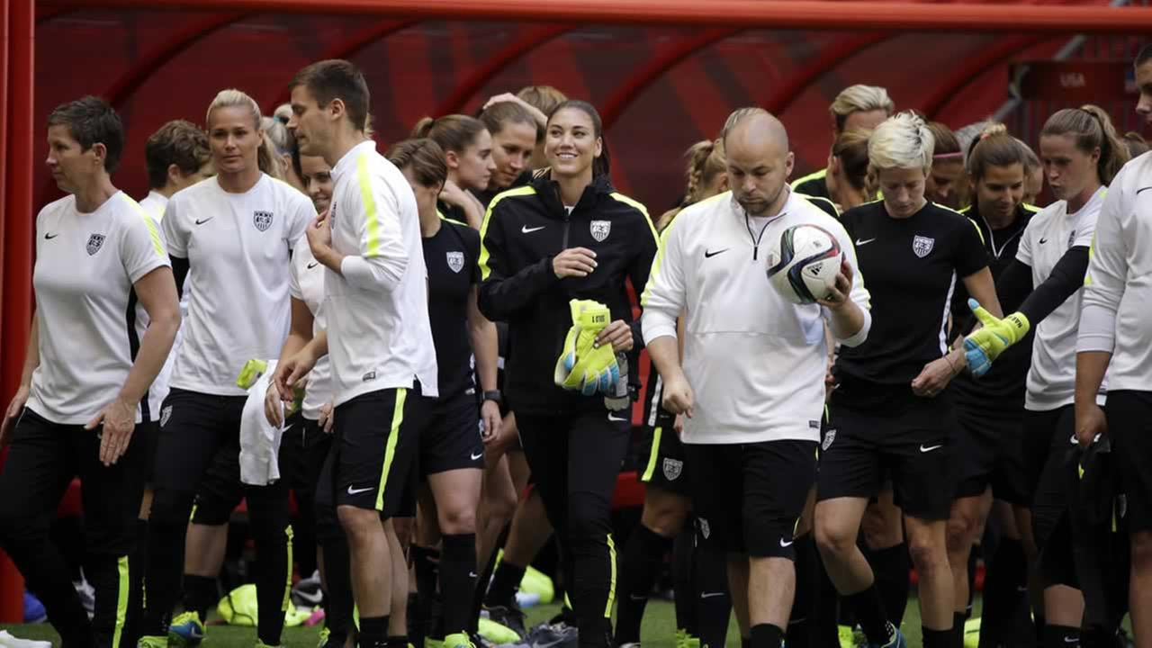 US goalie Hope Solo, center, and teammates walk onto the field for a practice for the Womens World Cup soccer final in Vancouver, British Columbia, Canada, Saturday, July 4, 2015.
