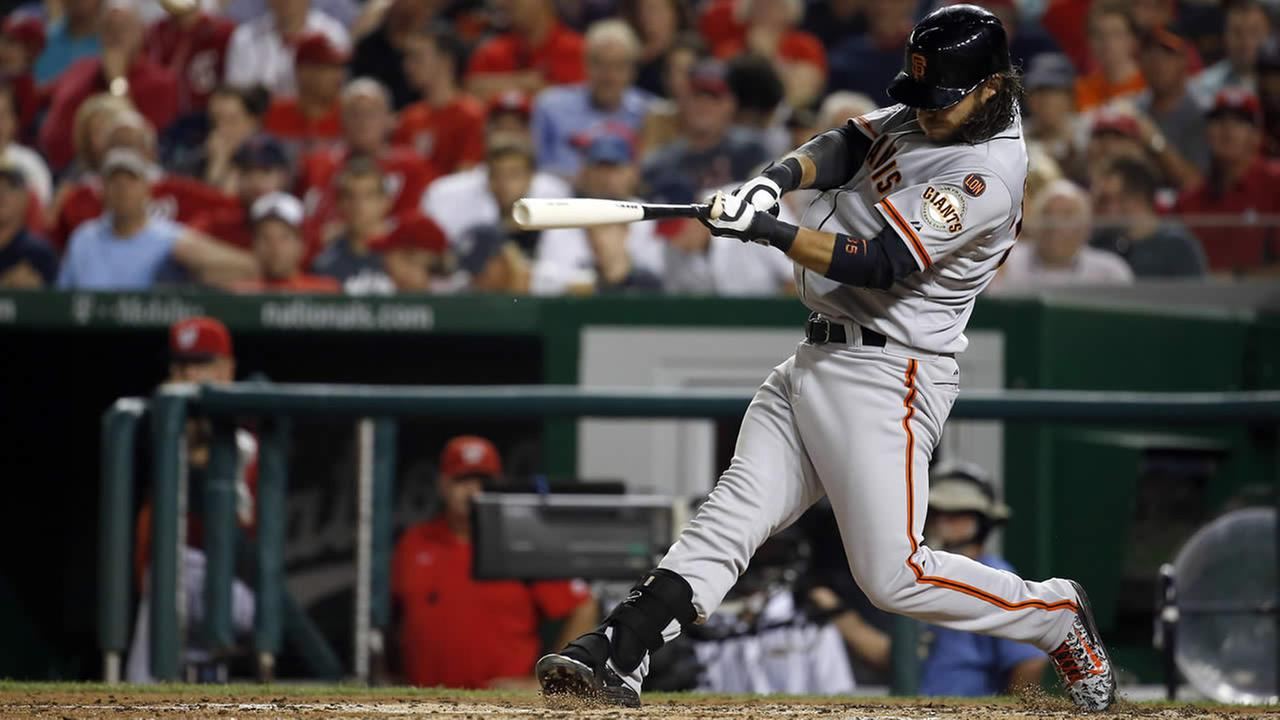 San Francisco Giants Brandon Crawford hits a solo home run during a game against the Washington Nationals at Nationals Park, July 5, 2015, in Washington. (AP Photo/Alex Brandon)
