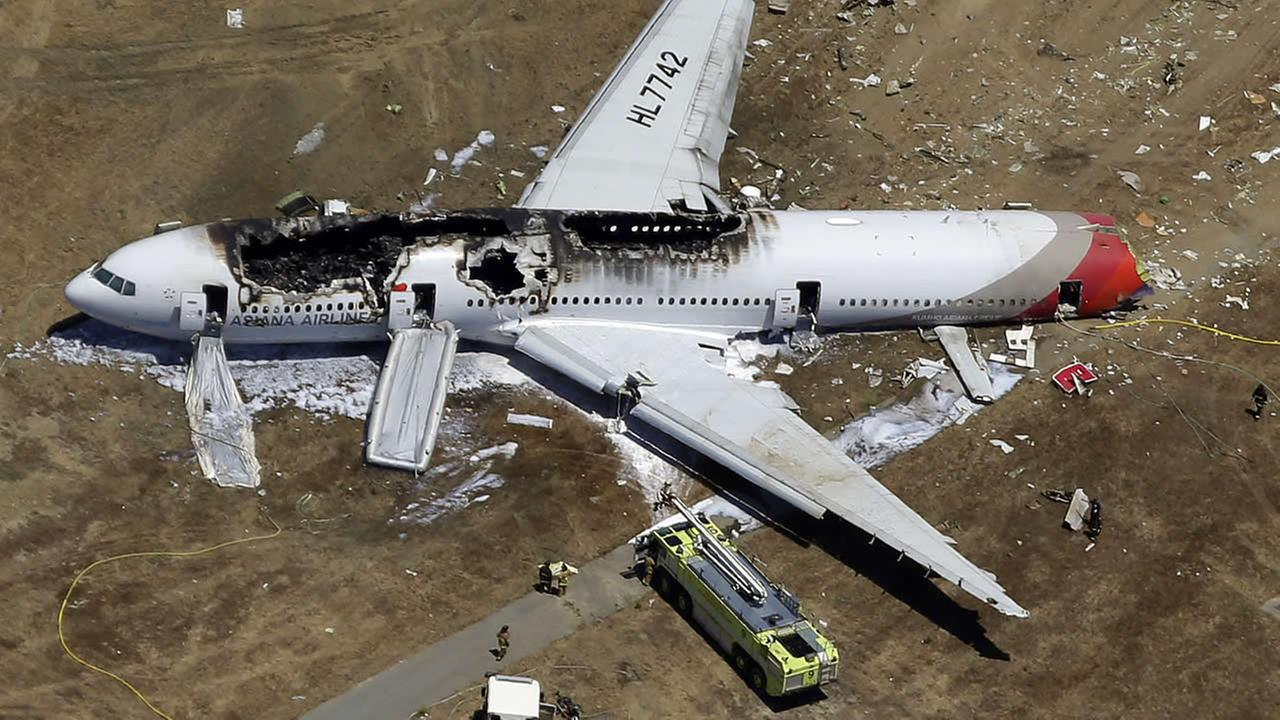 FILE - In this July 6, 2013, aerial file photo, the wreckage of Asiana Flight 214 lies on the ground after it crashed at the San Francisco International Airport in San Francisco.