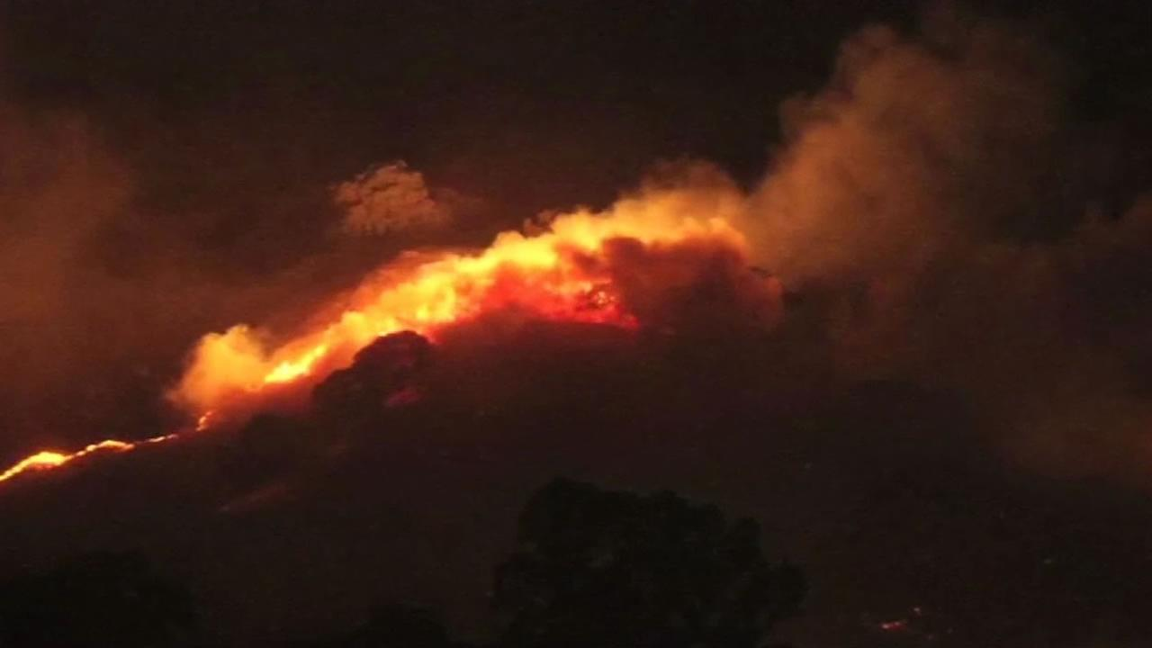 A four-alarm fire burned 320 acres near Keating Park in Vacaville, Calif. on Saturday, July 4, 2015.