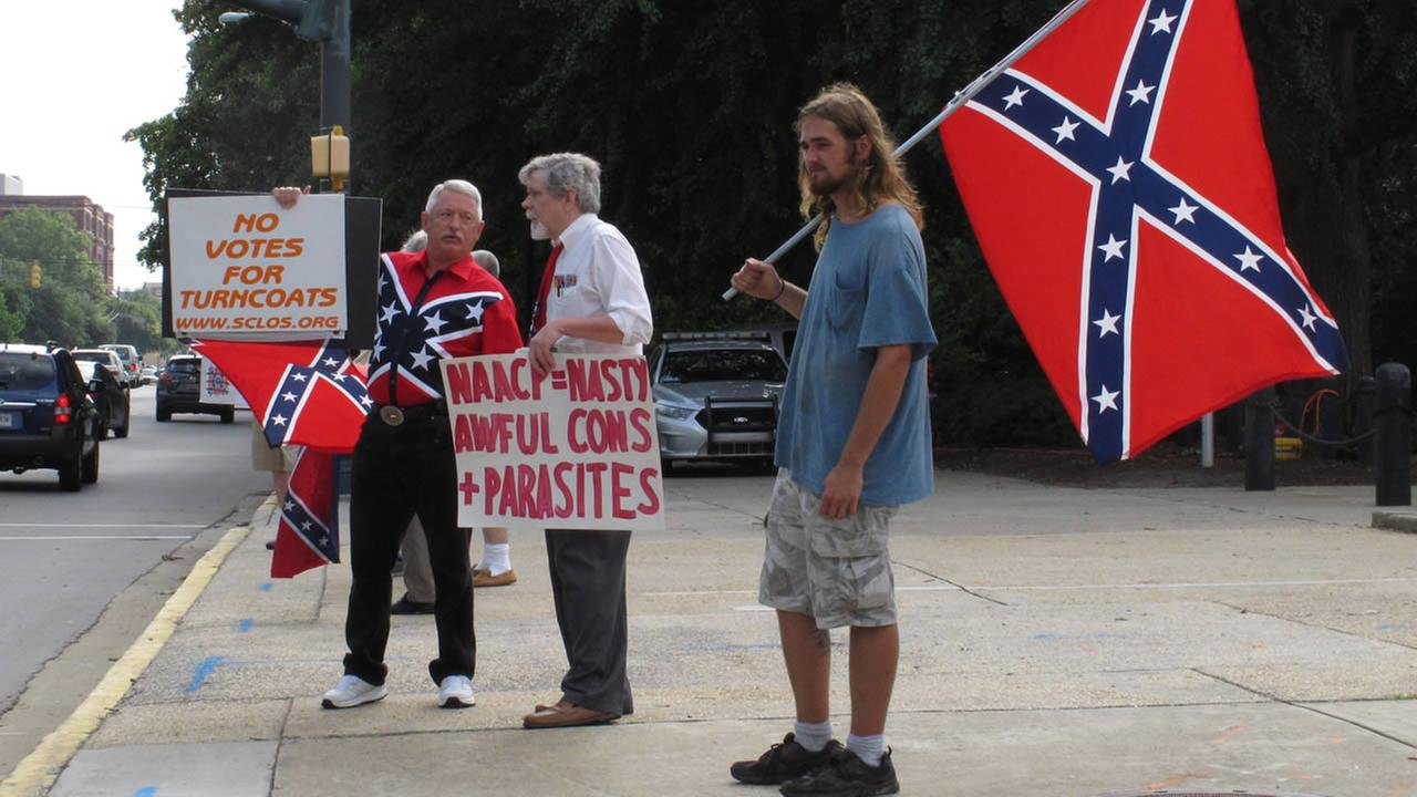 William Cheek, left, Nelson Waller, center, and Jim Collins, right, protest proposals to remove the Confederate flag on Monday, July 6, 2015 in Columbia, SC.