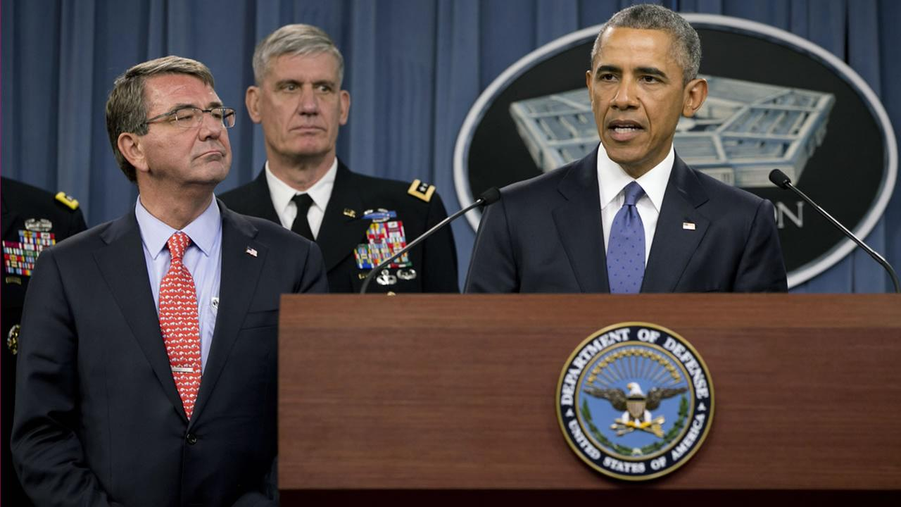 President Barack Obama, right, speaks to the media after receiving an update from military leaders on the campaign against the Islamic State, during a rare visit to the Pentagon.