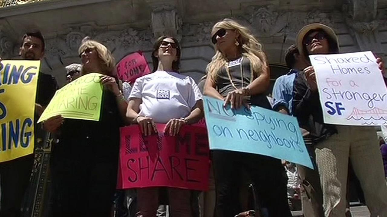 Airbnb supporters rally outside San Francisco City Hall