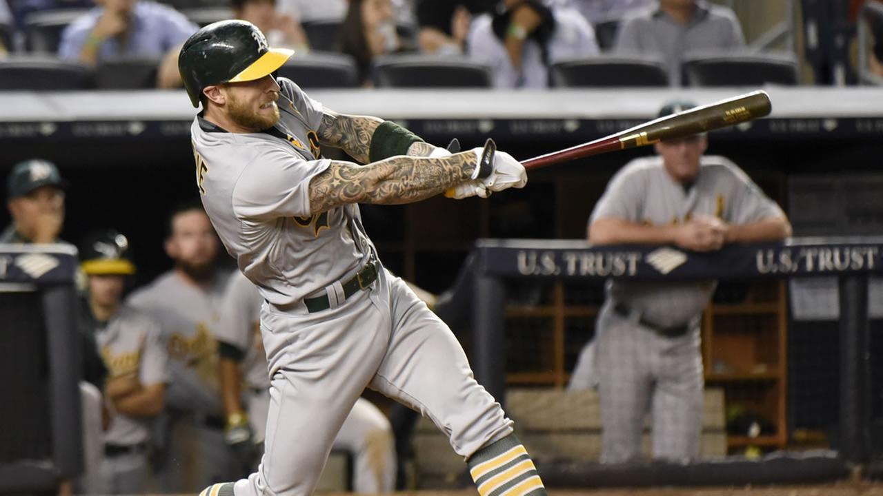 Oakland Athletics Brett Lawrie hits a home run during the 10th inning of a baseball game against the New York Yankees Tuesday, July 7, 2015, at Yankee Stadium in New York.