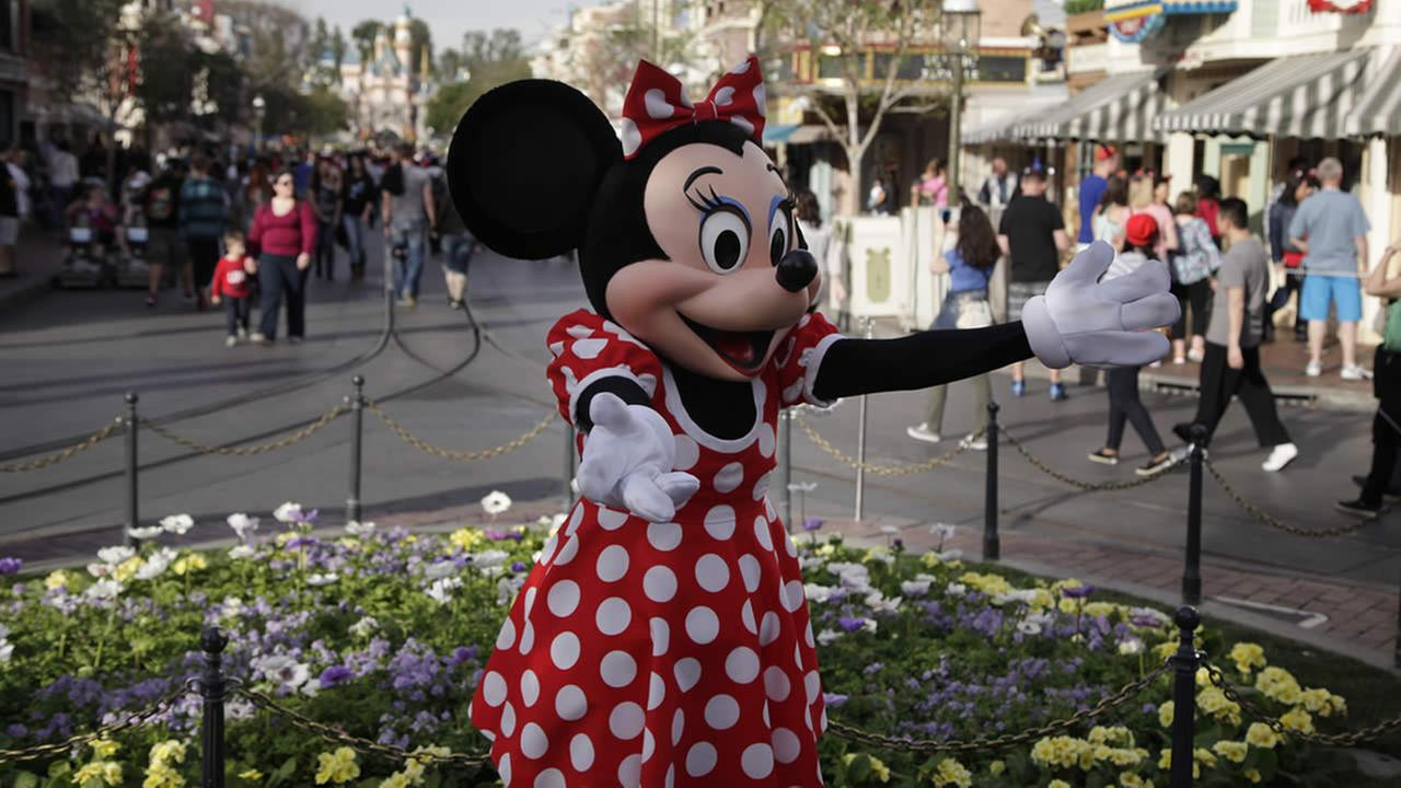 Minnie Mouse entertains visitors at Disneyland, Thursday, Jan. 22, 2015, in Anaheim, Calif. (AP Photo/Jae C. Hong)