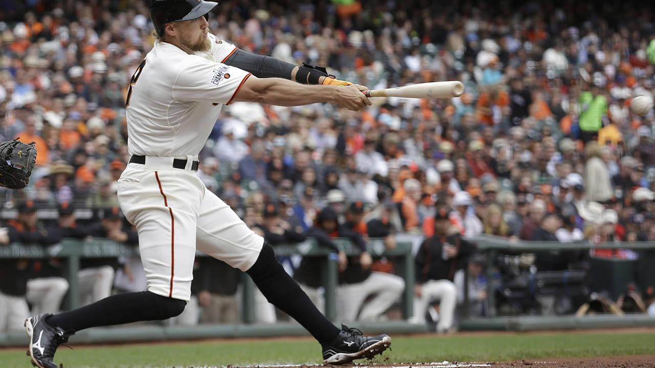 San Francisco Giants Hunter Pence hits a double against the New York Mets during the second inning of a baseball game in San Francisco, July 8, 2015. (AP Photo/Jeff Chiu)