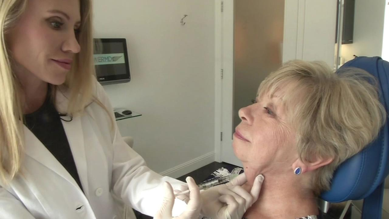 Dr. Karron Power administers a cosmetic treatment to Brenda Davis that will cure her of her sagging chin in Greenbrae, Calif.