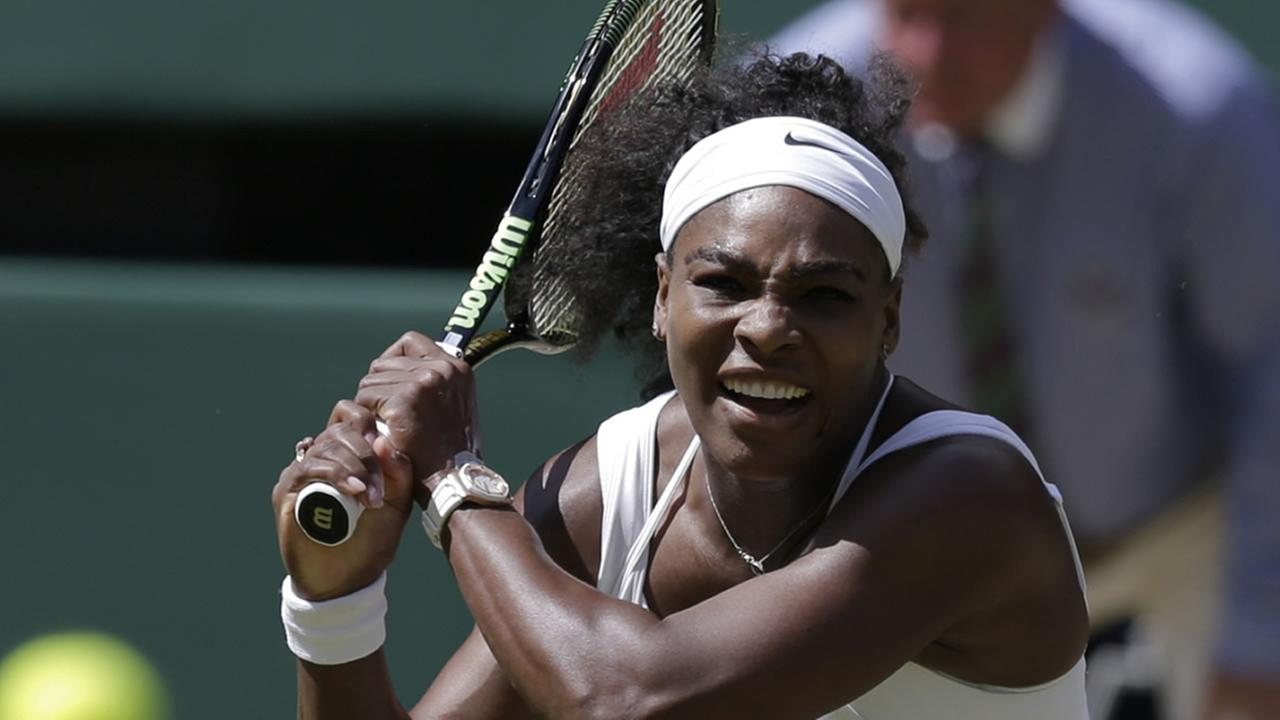 Serena Williams returns a shot to Garbine Muguruza of Spain during the womens singles final in Wimbledon, London, Saturday July 11, 2015.