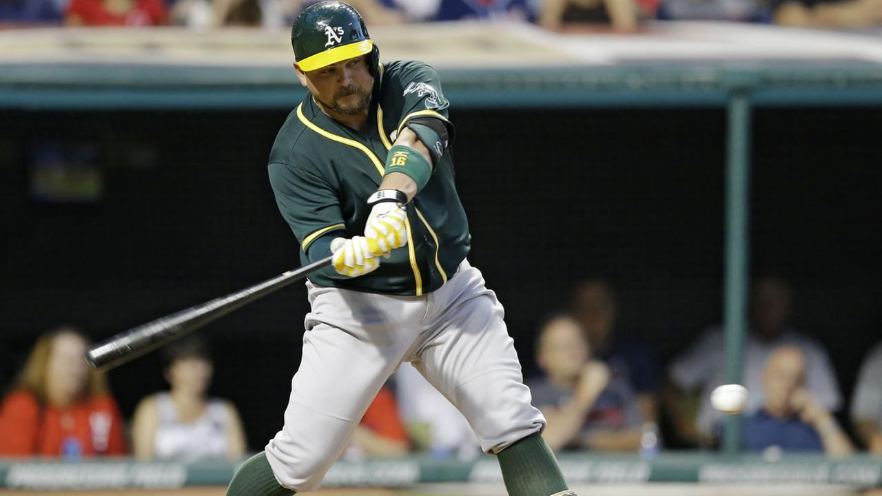 Athletics Billy Butler watches the ball before hitting a two-RBI double off Indians Bryan Shaw in the eighth inning of a baseball game on July 11, 2015. (AP Photo)