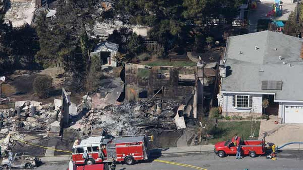 Aerial view of damage caused by a massive fire in a mostly residential neighborhood in San Bruno, Calif., Friday, Sept. 10, 2010. Fire crews tried to douse the remnants of an enormous blaze and account for the residents of dozens of homes Friday after a gas line ruptured and an explosion ripped through in a neighborhood near San Francisco.  <span class=meta>(AP Photo&#47;Jeff Chiu)</span>