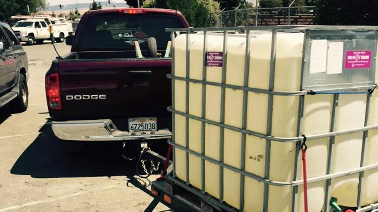 A truck hauls a tank to fill up on recycled water at the Dublin San Ramon Services District headquarters in Dublin, Calif. on Sunday, July 12, 2015.